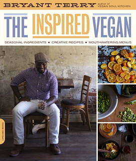 Cover of the Inspired Vegan, showing a photograph of Bryant Terry, a young black man, sitting on a chair with a drink in his hand