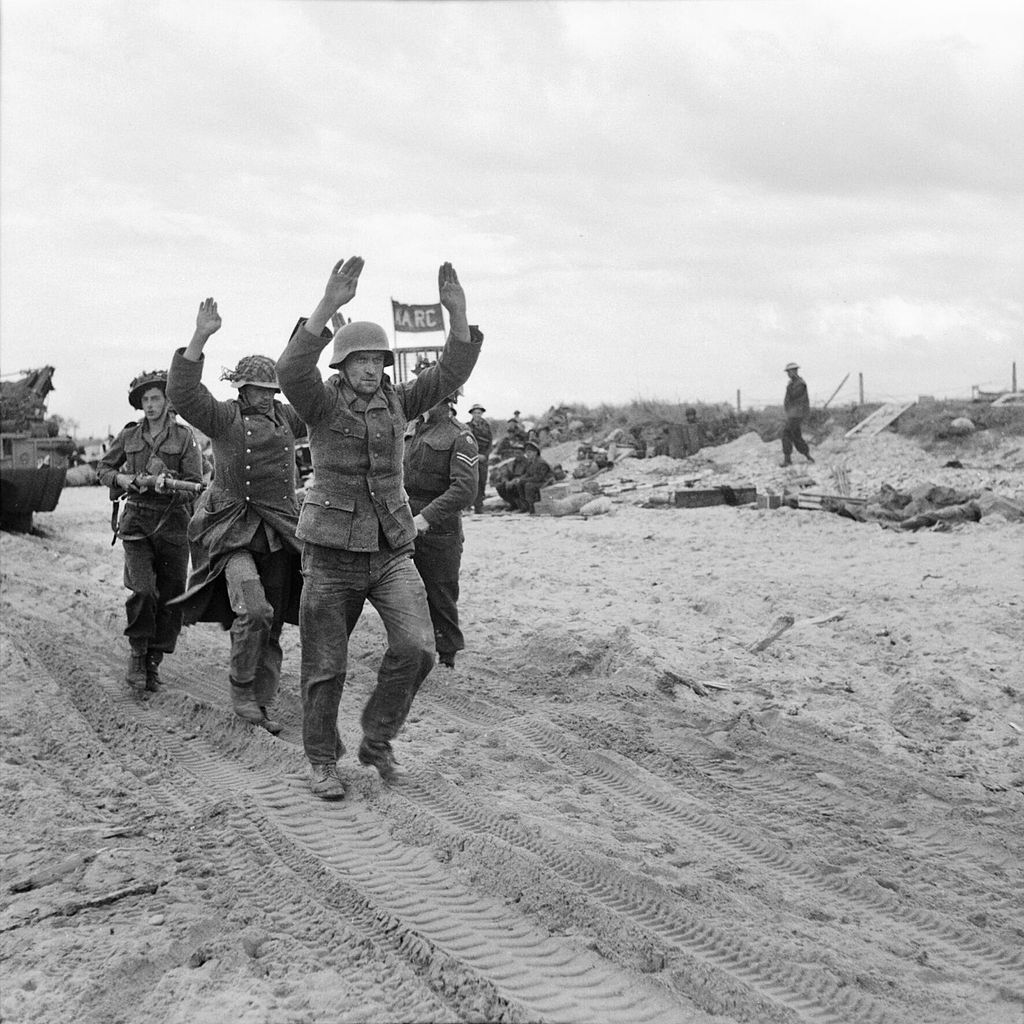 German POWs being escorted along one of the Gold area beaches, 6 June 1944.