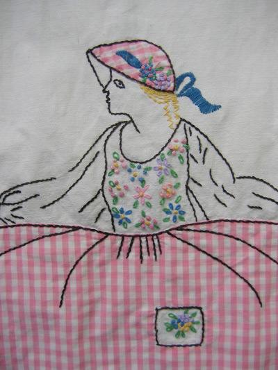 appliqued apron detail