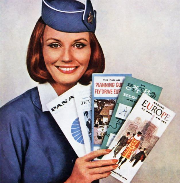 1963-Pan-Am-Flight-Attendant-with-brochures