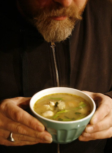 Holding soup in bowl