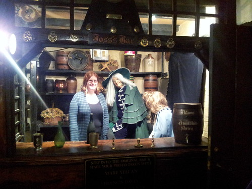Becky takes the opportunity to have her photo taken behind Joss's Bar with Francis Davey and Mary Yellan at Jamaica Inn