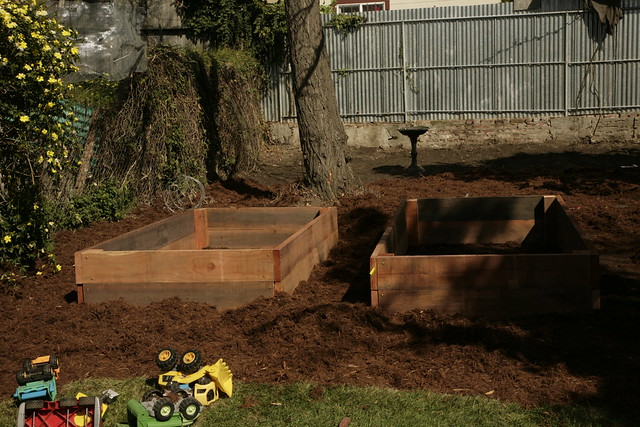 Empty raised beds and toys.