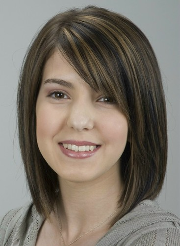 Medium length brunette with highlights by colourauthority.com