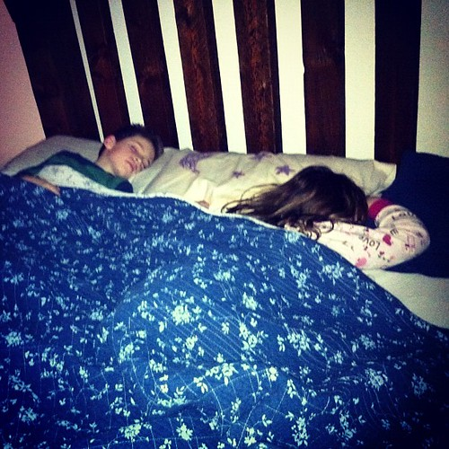 Two kids in my bed with me, one on a mattress on the floor next to me. By morning, I will have taken Emily's feet out of my ribs many times, physically moved her off of me even more times, and will likely wake up in the morning hanging onto the edge of my