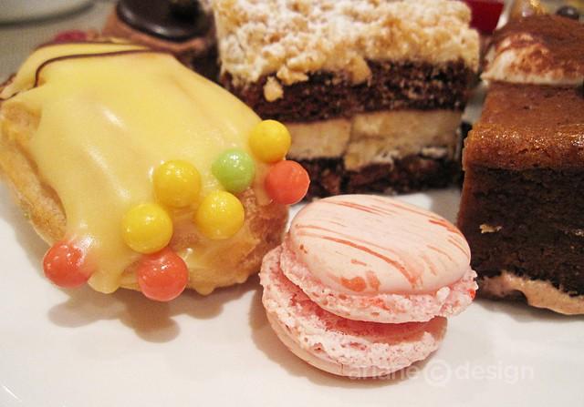 Eclairs, macaron, red velvet cake (rear)