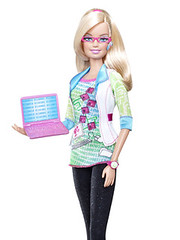 computer engineer Barbie, wearing pink glasses and holding a laptop