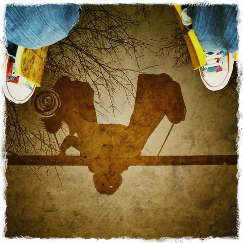#fromwhereistand - suspended on the swings over a puddle
