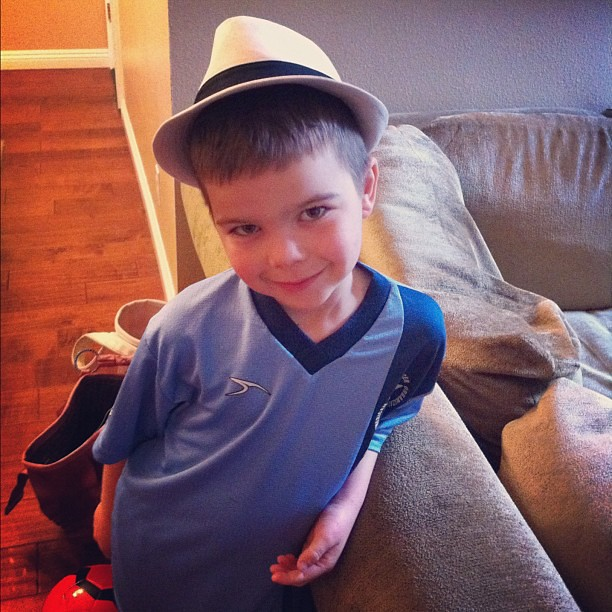Angry Kid is sporting @elislids newest edition, the fedora. It goes well with his soccer uniform, doesn't it?