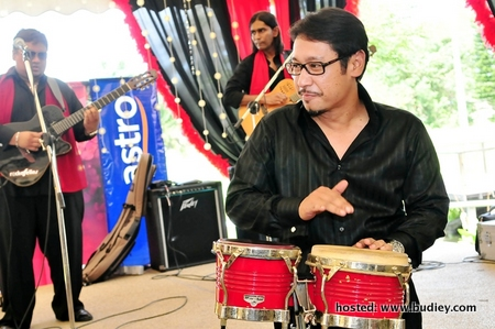 Malay Language Business Vice President Khairul Anwar Salleh officiating the Astro Bella channel by playing the Bongo drum.