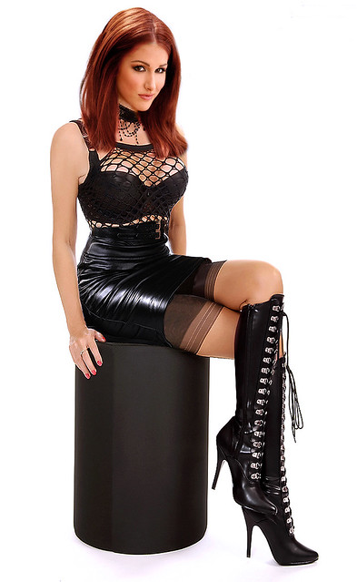 The leather domina spike dildo and female slave