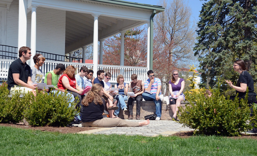 A theatre class meets outside the Norris-Wachob Alumni House.