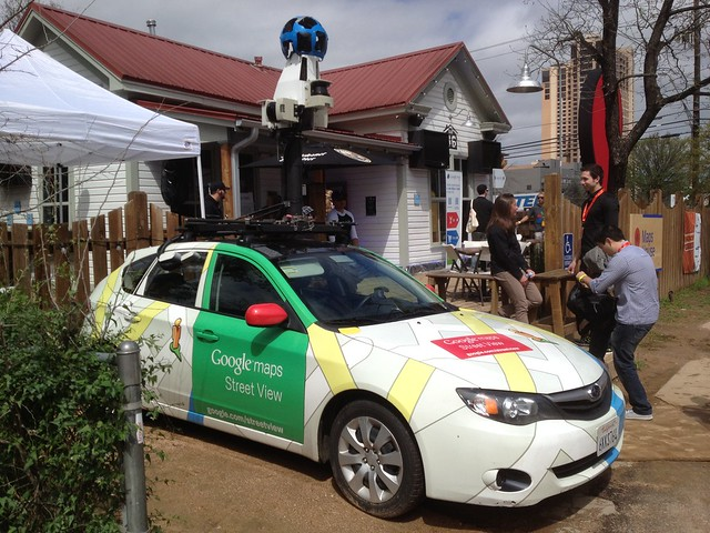 Google Streetview car in the Google Village