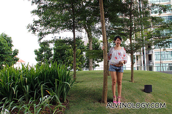 Blogger Christine posing by a tree