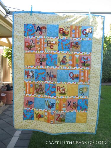 A alphabet baby quilt by saffronbee1