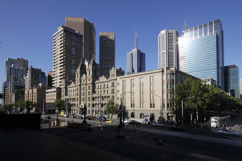 Skyscrapers tower over Spring Street and Melbourne's Hotel Windsor