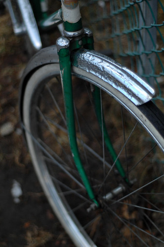 green bike, front wheel