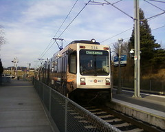 A southbound train pulls into the Flavel Street station