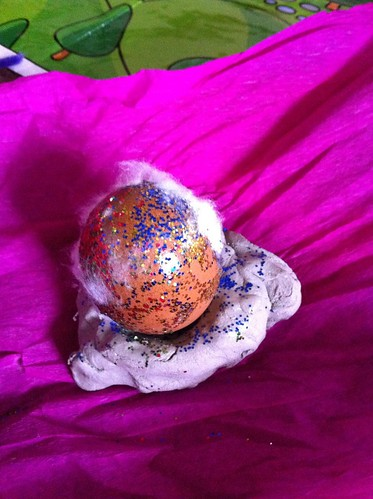 Glittery egg in clay nest, as made by Owen