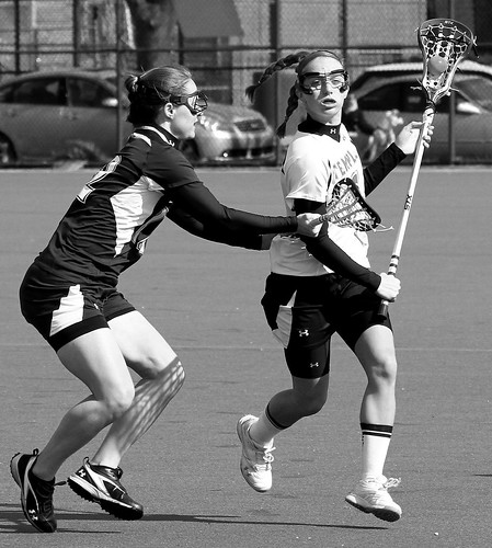 Temple's #6 Junior Midfielder Charlotte Swavola and Mount Saint Mary's #22 Senior Midfielder Meaghan Conlon