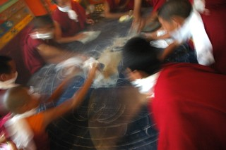 Young Tibetan Buddhist monks wearing khatags for masks quickly clean up the Hevajra sand mandala to be placed in a nearby river, drawing, Sakya Lamdre, Tharlam Monastery, Boudha, Kathmandu, Nepal