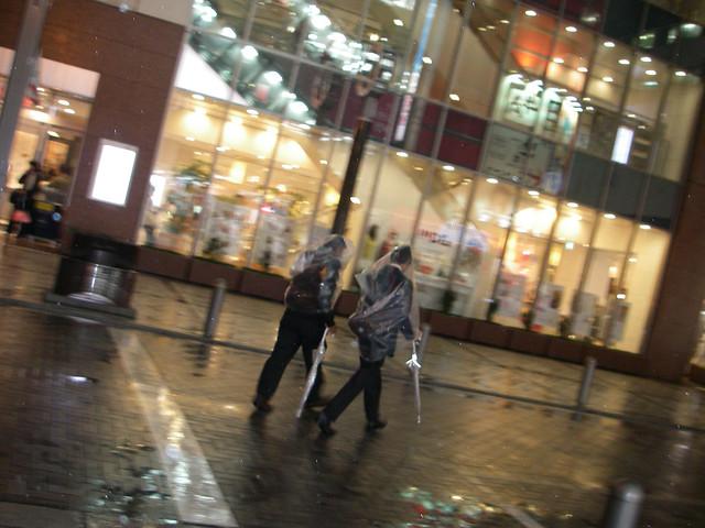 people wearing vinyl bag: JR Akihabara station : 3 April 2012 : Akihabara was hit by the storm of spring