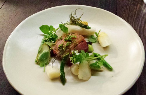 Roasted duck, pistachios, green and white aspsragus, watercress, green strawberries
