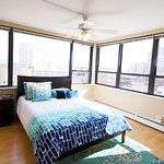 Walls of windows in this bedroom provide all the good views of downtown Evanston.