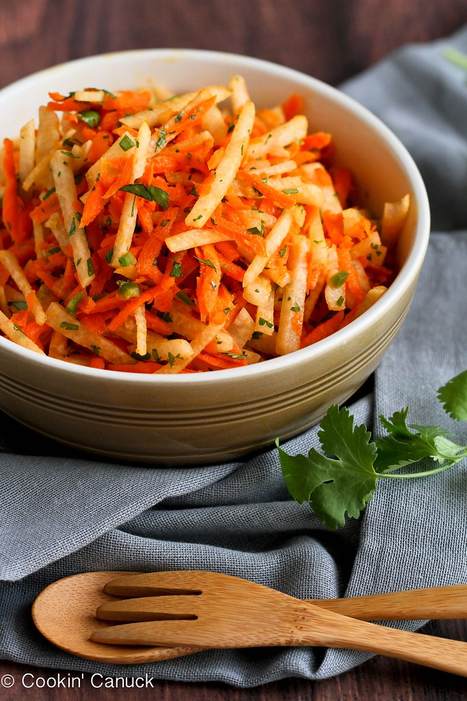 Jicama and Carrot Slaw Recipe with Honey-Lime Dressing...A fantastic vegan slaw to tuck into tacos or eat on its own!  54 calories and 1 Weight Watchers PP