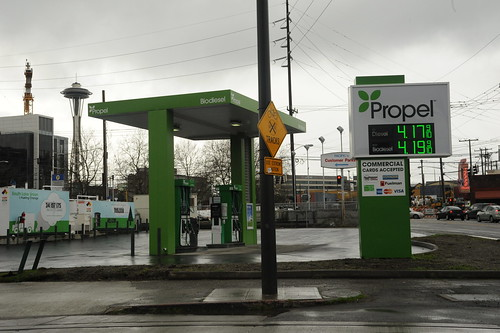 Green Propel Biodiesel station, commercial cards accepted, Space Needle, power cords, rainy day, Seattle, Washington, USA by Wonderlane