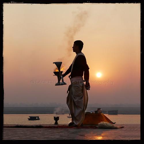 people sun india man water mystery sunrise river square dawn boat colours faith religion atmosphere soul varanasi ritual priest spirituality shiva devotee hindu dharma hinduism kashi backlighting ganga ganges benares benaras uttarpradesh worshiper gangaaarti भारत indiasong