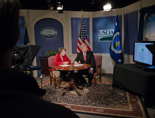 Agriculture Secretary Tom Vilsack and Agriculture Deputy Secretary Kathleen Merrigan received a question via twitter message while in the USDA TV studio, during the unveiling of the Know Your Farmer, Know Your Food (KYF) Compass, an interactive web-based document and map highlighting USDA support for local and regional food projects and successful producer, business and community case studies. While hosting a live webinar to highlight USDA's work over the past three years, the Secretaries emphasized how local and regional food systems across the country create additional economic opportunities for farmers, ranchers and food entrepreneurs, expand healthy food access and meet growing customer demand. At the U.S. Department of Agriculture in Washington, D.C., on Wednesday, February 29, 2012. USDA Photo by Lance Cheung.