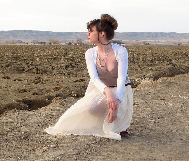 White skirt kneeling