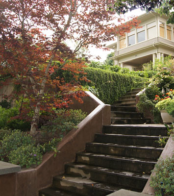 A new stairway leads the visitor from the street to the house.