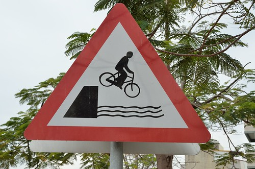 Warning: bicycle falling in water.