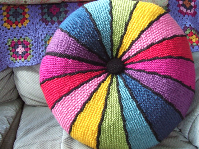 Knitted rainbow cushion