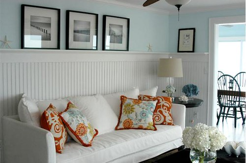 pale blue walls orange accents beach feeling