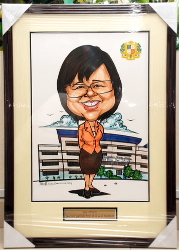 Caricature for Principle of St. Gabriel's Primary School - framed up with metal engraving plate