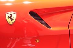 wheel(0.0), bumper(0.0), automobile(1.0), automotive exterior(1.0), vehicle(1.0), ferrari 458(1.0), red(1.0), automotive design(1.0), land vehicle(1.0), luxury vehicle(1.0),
