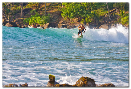 Surfing at Mirissa beach