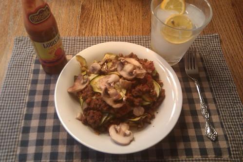 Paleo lasagna with mushroom and hot sauce.  Club soda w/ lemons.  Yum Yum