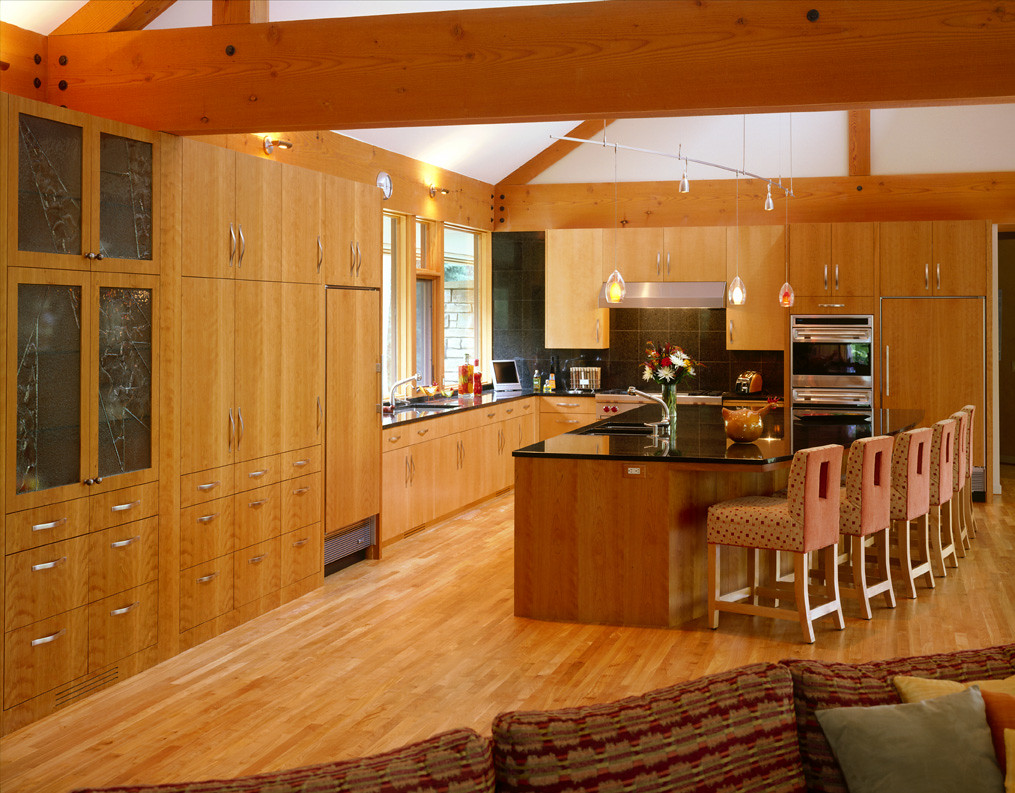 Kitchen of slab wood cabinets with large center island view on