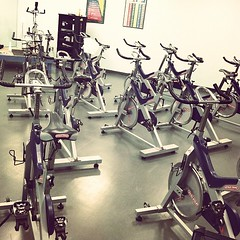 arm(0.0), sport venue(0.0), muscle(0.0), physical fitness(0.0), machine(1.0), room(1.0), indoor cycling(1.0), gym(1.0),