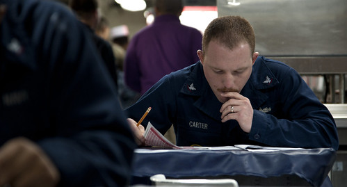 120309-N-LP801-002 PACIFIC OCEAN (March 9, 2012) – Hospital Corpsman 3rd Class Troy Carter takes his E-5 advancement exam.