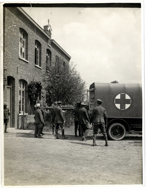 Casualty leaving field ambulance for clearing station [La Gorgue, France]. Photographer: H. D. Girdwood.