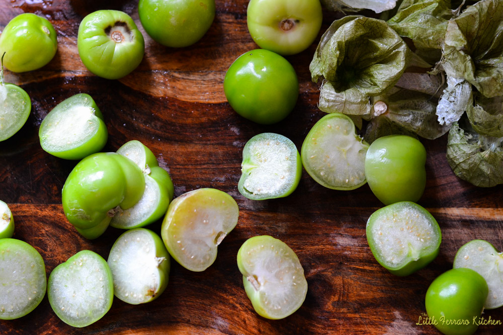 Authentic chile verde recipes begins with fresh and husked tomatillos.