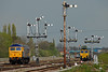 47843 light engine from Immingham to Hexthorpe passes the array of semaphores at Barentby vai the Brigg line as 66525 runs up the DGL to  the Newark line 24-04-14 by harry hudson