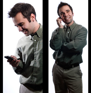 Can You Hear Me Now? (2012) - Photographer Michael Vujovich posing with a smartphone against a bright white background for a commerical photography project