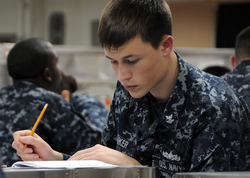 Yeoman 2nd Class Kyle Parker takes his first class petty officer advancement examination.