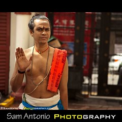 Warding off Photographers in Singapore's Chinatown